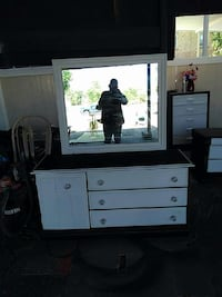 white and black wooden sideboard with mirror