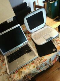 white and black laptop computer Toronto, M4X 1G3