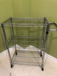 "Kitchen metal rolling cart.  Pickup only delivery not included.  L = 24"" x W= 14"" x H=33.5""  note handles is 7"" from the body Mississauga, L5V 1S8"