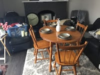 Natural hardwood dining room set with 4 chairs and 1 leaf in top shape. Can be round or oblong.   I refurbish furniture so I can offer to paint the top of the table in a different color for free.   St Catharines, L2P 3L2