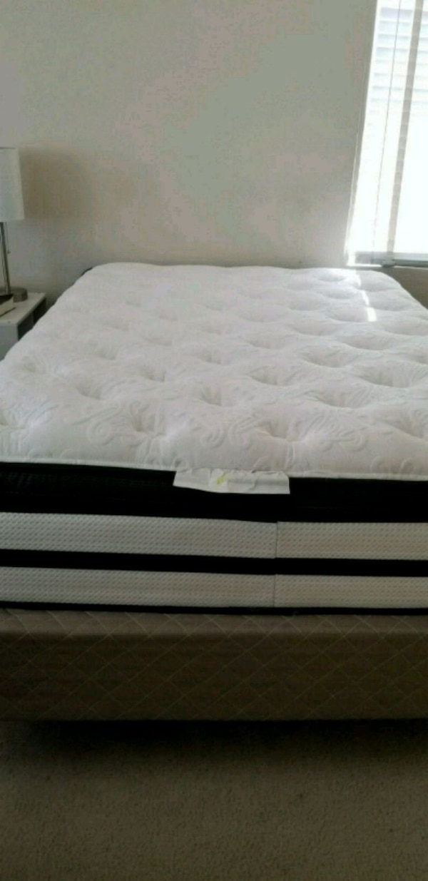 white and black bed mattress