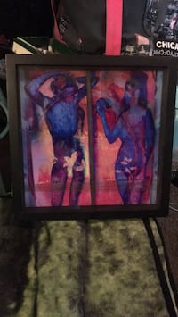 black wooden framed painting of woman