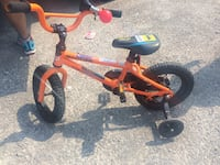 black and orange Mach One bicycle with training wh Toronto, M3M 2V7