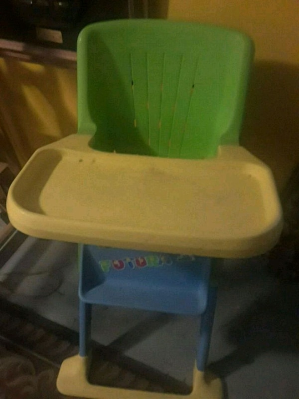 white and green plastic high chair