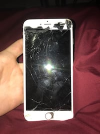 cracked white Samsung Galaxy android smartphone
