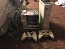 Xbox One console with two controller and game case