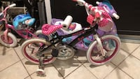 Toddler's pink and white bicycle with training wheels hello kitty
