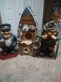 two black and brown ceramic figurines 3486 km