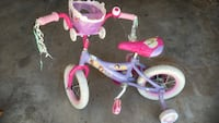 Toddler's pink and purple bike with training wheels