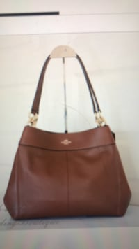 Coach 28997 Lexy leather shoulder handbag with matching coach wristlet and coach key chain.  Saddle  Centerport, 11721
