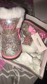 pair of pink glittered juicy couture boots .  Washington, 20020