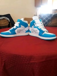 blue-and-white adidas low-top sneakers 2241 mi