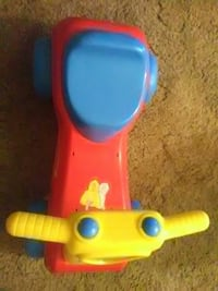 toddler's red and blue plastic ride-on toy