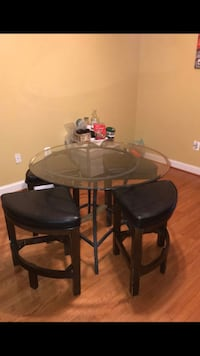 Glass table w/ 4 brown chairs Fairfax, 22030