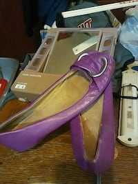 pair of women's purple leather flat shoes