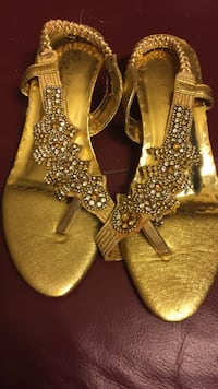 pair of gold-colored thong sandals Windsor, N9A 4R1