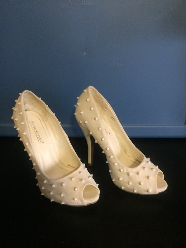 Pair of white studded stiletto shoes