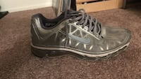 pair of gray Nike basketball shoes
