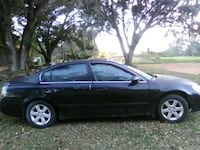 black 5-door hatchback Polk City