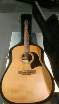 brown dreadnought acoustic guitar with black case