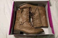 pair of brown leather side-zip boots
