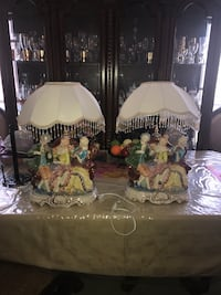 Two fringed man and women theme table lamps