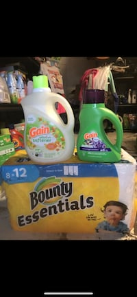 two white-and-green Gain detergent bottles Palmdale, 93550