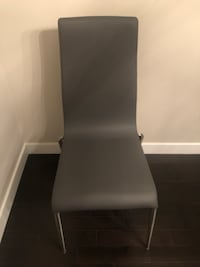 Grey metal framed grey leather padded chair