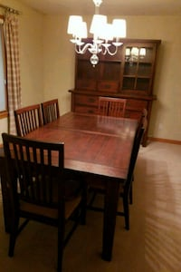 rectangular brown wooden table with six chairs din Girard, 44420