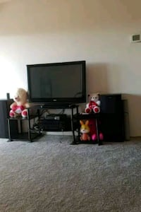 flat screen TV and black wooden TV stand Sterling Heights, 48311