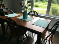 rectangular brown wooden table with four chairs di Cobourg, K9A 4J7
