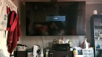 black flat screen TV with remote Sharon Hill, 19079