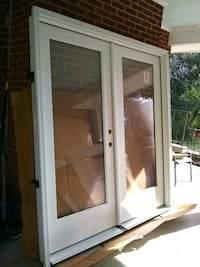 white wooden framed glass door