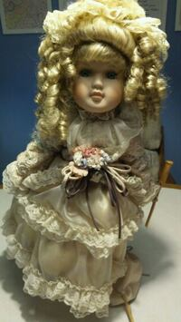 Antique doll with purse