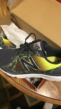 Pair of gray-and-yellow New Balance running shoes with box St. Louis, 63116