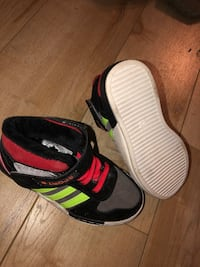 pair of white-and-black Nike slide sandals Laval, H7W 1T6