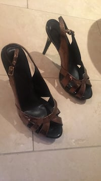 Pair of black leather peep-toe heeled sandals Burlington, L7P 0B4