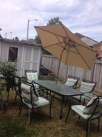 Brand new 8 feet umbrella , and good condition table with chairs include cushions Vaughan, L4H 1Y4