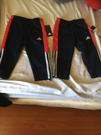 Two black-and-red adidas pants