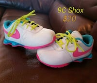 toddler's white-pink-and-teal Nike shoes