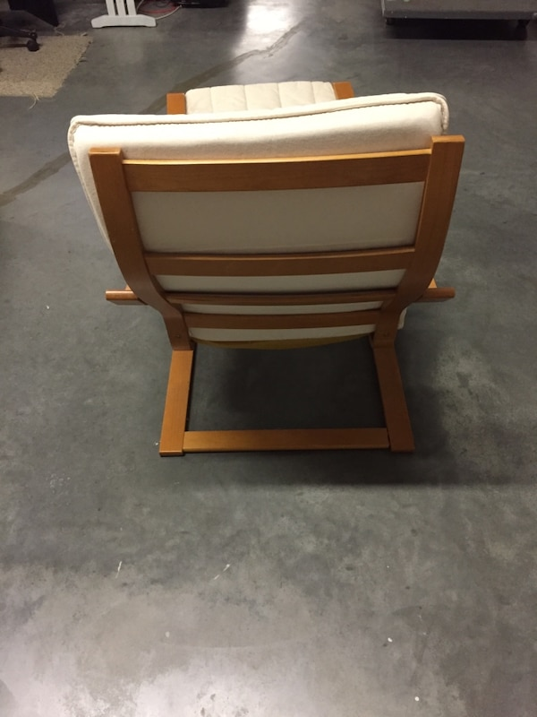 Brown wooden frame white padded armchair f7002596-20f2-4a3c-af9f-4a98b3757be3