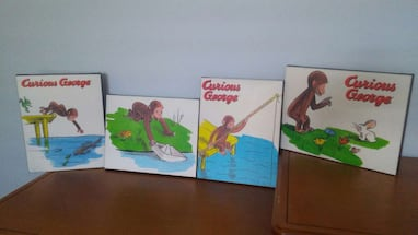 set of 4 Curious George wall art.