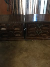 two brown wooden 2-drawer nightstands