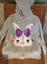 gray and pink Hello Kitty print sweater Kirkland, H9H