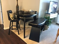 round black wooden table with four chairs dining set Rhodesdale
