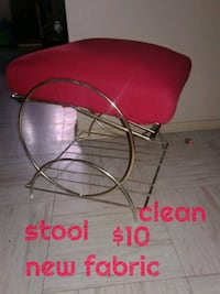 red and black metal chair