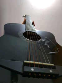 black and brown acoustic guitar 13673 km