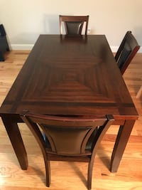 rectangular brown wood table with three chairs dining set North Bergen, 07047