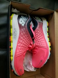 pair of pink Nike running shoes Parkland, 33067