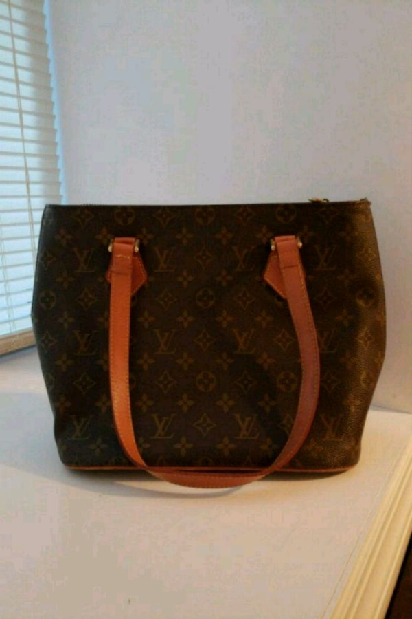 e0cb471de76c Used brown and black Louis Vuitton leather tote bag for sale in New York -  letgo